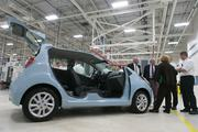 Guests get a look at the Chevy Spark EV during a GM event celebrating the first electric motor at their Baltimore manufacturing plant. The motor is the first electric motor built in the U.S.