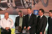Gov. Martin O'Malley, center, lifts a portion of the new e-motor during a GM event celebrating the first electric motor manufactured at the Baltimore plant. The motor is the first electric motor built in the U.S. and will be used in the Chevy Spark EV. Baltimore County Executive Kevin Kamenetz, right, looks on.