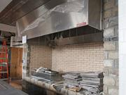 Spike Gjerde will use an open hearth for cooking at Parts and Labor. Above, the space under construction.