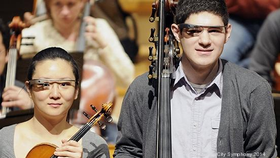 Kansas City Symphony violinist Heidi Han, double bass player Evan Halloin,  French horn player Elizabeth Schellhase Gray, wear Google Glass as they prepare for rehearsal.