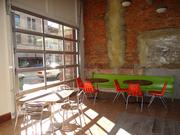 The rollup garage-style door at the front of the 3,000-square-foot restaurant space will be up when weather permits.