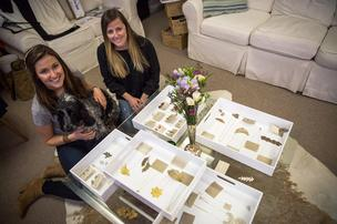 Gabe Bratton (left) owner of Gabrielle Jewelry with English Spaniel Dash and Catherine Fain (right), owner of Ramey Rhodes, with Bratton's line of jewelry featuring lace cast into metal.