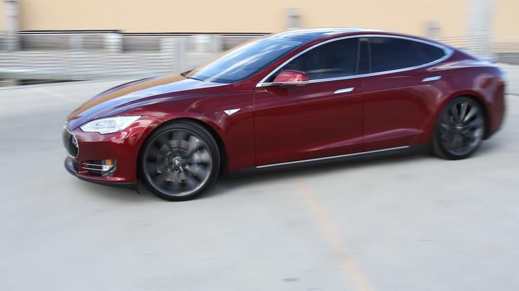 Teslas like the one pictured run on lithium ion batteries. Though everyone in New Mexico is watching Tesla Motors for its next move, the announcement that General Motors will spend $450 million on a battery plant for its new electric cars also has the automotive world buzzing.