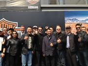Walker poses with Harley-Davidson fans in China. Also present is Tim Sheehy, Metropolitan Milwaukee Association of Commerce president, second row, third from left.