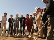 Officials lined up for a ground breaking of Brooklyn Basin on Thursday.