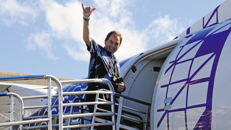 Hawaiian Airlines President and CEO Mark Dunkerley waves as he boards the flight to Molokai.  2