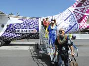 Passengers on the airline's maiden flight included Sig Zane and his wife, Nalani Kanakaole.