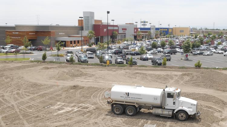 The RiverPoint Marketplace, seen here in 2009, will be one of the retail centers put on the market by The Buzz Oates Group of Cos.