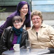From left, Jessica Sklar, Shawna Holman, who watched Sklar's house and cats while Sklar was ill, and Sklar's health advocate Beck Royer, of Allied Health Advocates, catch up at a Columbia City coffee shop in Seattle. Royer pushed doctors to give Sklar a medication she could take in one dose instead of over several days, and helped Sklar find a care center for rehabilitation.