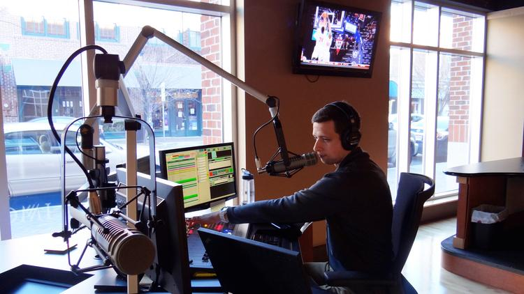 Chris Kroeger, a producer with IMG College, is one of a team of more than 200 that brings fans radio broadcasts of their favorite college basketball team during conference tournament time from IMG College's downtown Winston-Salem studios.