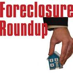 Developer under fraud indictment faces foreclosure on commercial properties