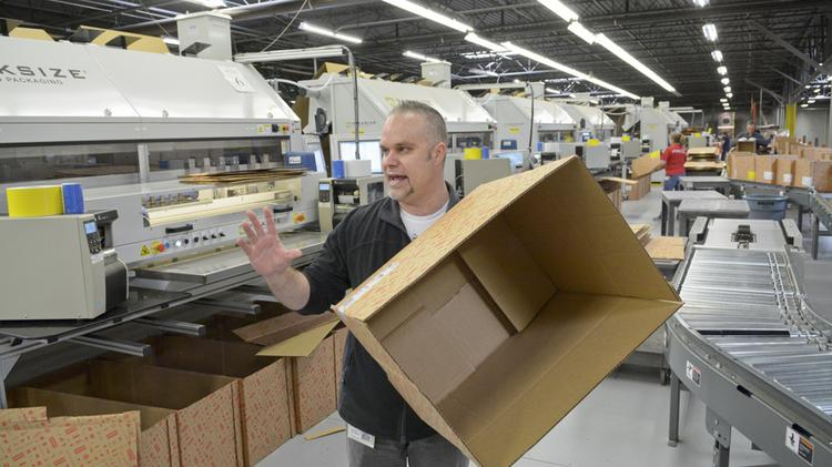 Operations manager Dave Pina explains how a machine custom builds boxes per order to cut down on waste.