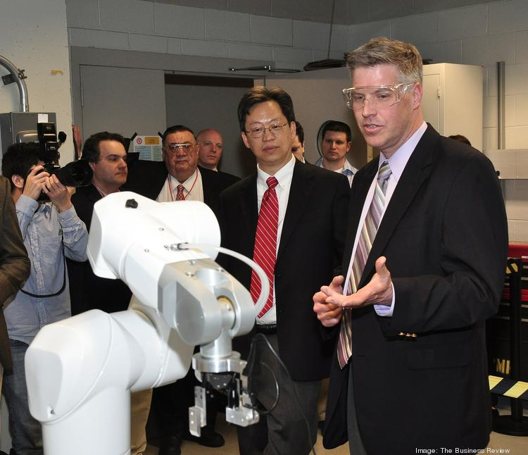 John Wen, director of RPI's Center for Automation Technologies and Systems (middle) and Dr. Patrick Gallagher, director of the National Institute of Standards and Technology tour the robotics lab.