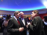 L to R- At the March 15 Seattle Rep Gala, community leaders and longtime Seattle Rep supporters Stan Barer and Stan Savage are deep in conversation with Seattle Repertory Theatre's managing director Ben Moore about his plans after he retires June 30.