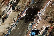 Trash still lines Boylston Street just beyond the marathon finish line the day after as the scene was considered a crime scene.