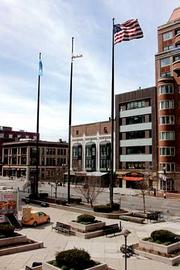 While flags across the nation were lowered to half mast due to the Boston Marathon bombings, flags in the deserted plaza outside the Prudential Center remained at full height, the day after the bombings.