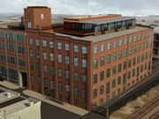 An artist's rendering depicts how the exterior of a warehouse at 111 W. Heath St. in Baltimore will look after it is converted to apartments.