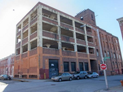 A developer plans to convert a former warehouse at 111 W. Heath St. near Federal Hill into 60 luxury apartments.