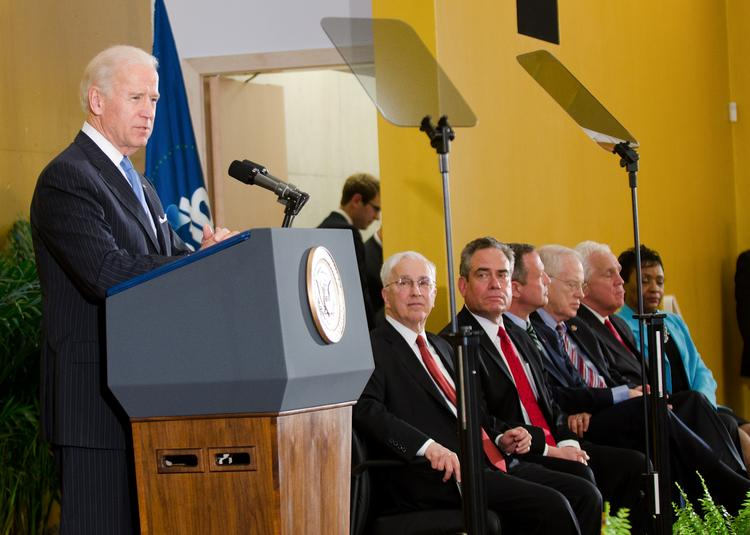 """Vice President Joe Biden address a crowd Tuesday evening at the new University of Baltimore law center. Joining him from left to right: UB President Robert L. Bogomolny; UB law school dean Ronald Weich; Gov. Martin O'Malley; University System of Maryland Chancellor William E. """"Brit"""" Kirwan; Senate President Thomas V. Mike Miller; Del. Adrienne Jones"""