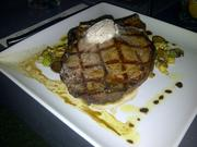 The 12 oz. rib eye at Xen Lounge is aged 33 days and served under a pat of marrow butter.