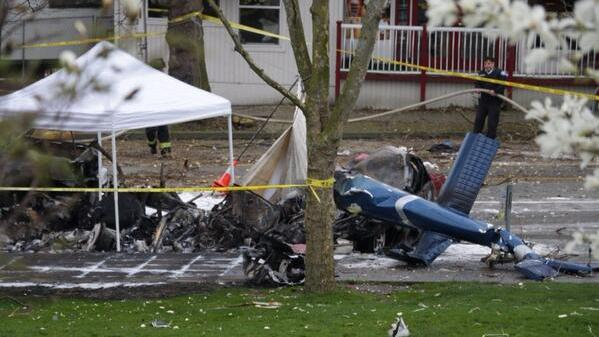 Wreckage of a news helicopter could be seen near the Space Needle Tuesday morning.