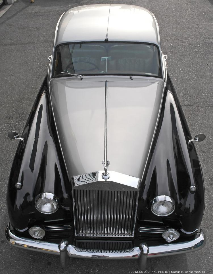 A 1957 Rolls-Royce Silver Cloud in black and silver is one of the cars in the British Motor Coach fleet.