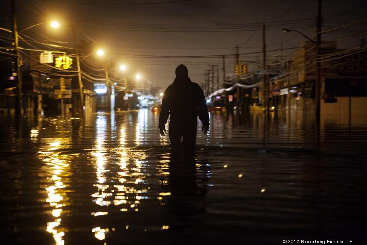 A man wades through flood waters on Hylan Boulevard on Staten Island, on Tuesday, Oct. 30, 2012.