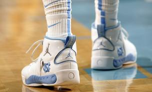 A University of North Carolina basketball player wears Nike Jumpman shoes during a NCAA college game in Chapel Hill, North Carolina, U.S., on Sunday, Nov. 15, 2009.