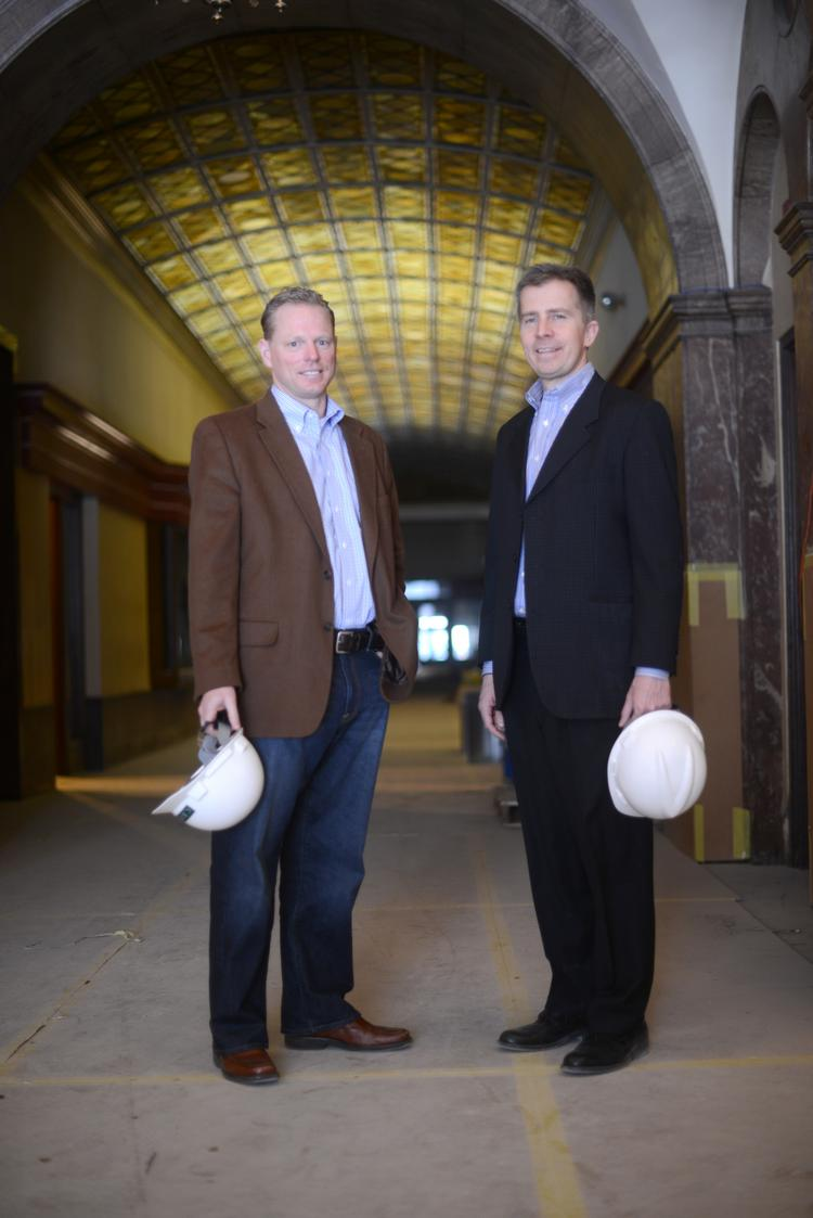 Jerry Baack, CEO of Bridgewater Bank (left), and Rich Pakonen, co-owner of Pak Properties, stand in the Pioneer Building in St. Paul.