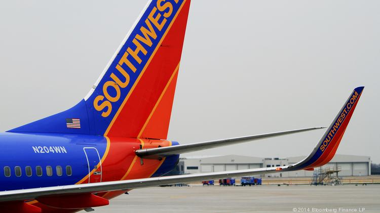 A Southwest Airlines flight on its way to Sacramento was diverted after a passenger tried to open a door mid-flight.