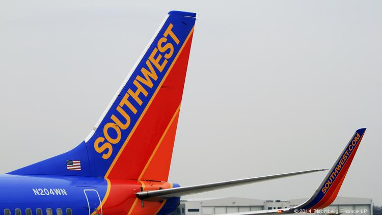 A Southwest Airlines Boeing 737-7H4 plane sits at a gate at Dallas Love Field Airport in Dallas on Feb. 3, 2014. Southwest will add nonstop flights from Reagan National Airport to several new cities, including Dallas Love Field, and expand existing routes, more than doubling its National Airport service to 44 daily flights and 14 cities.
