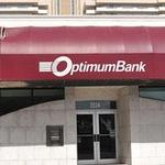Former OptimumBank director suspended after fraud indictment