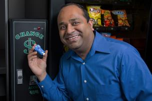 Paresh Patel, CEO of PayRange, holds the BluKey device that his company developed. The device allows payment machines to accept mobile payments.