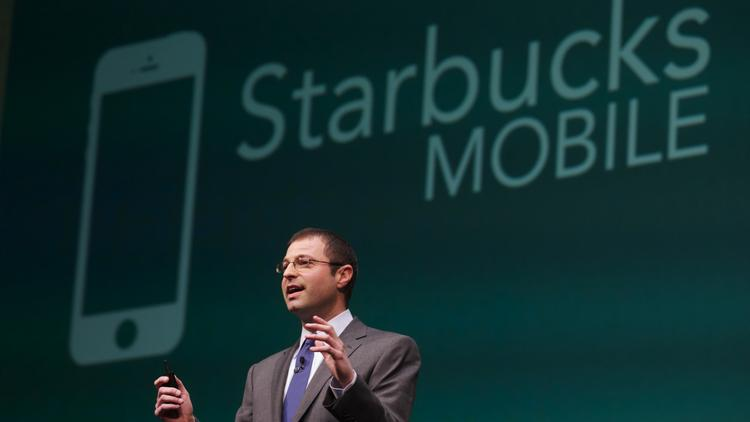 Starbucks Chief Digital Officer Adam Brotman discusses improvements to the company's iPhone app at the Starbucks annual shareholders meeting at McCaw Hall in Seattle March 19.
