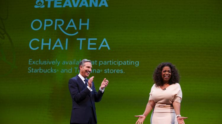 (BUSINESS JOURNAL PHOTO   Stephen Brashear) Starbucks CEO, President and Chairman Howard Schultz, left, and Oprah Winfrey introduce Oprah Chai during the Starbucks Annual Shareholders Meeting at McCaw Hall in Seattle Wednesday March 19, 2014.