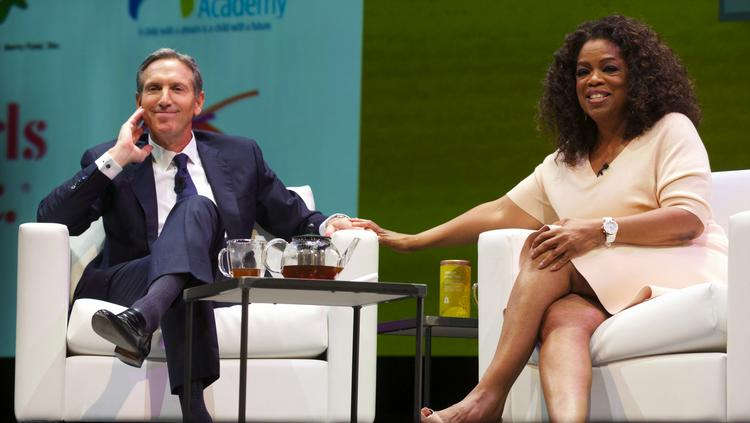 Starbucks CEO, President and Chairman Howard Schultz, left, and Oprah Winfrey introduce Oprah Chai during the Starbucks annual shareholders meeting at McCaw Hall in Seattle on March 19.
