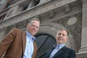 Jerry Baack, CEO of Bridgewater Bank (left), and Rich Pakonen, co-owner of Pak Properties, stand in front of the Pioneer Building.