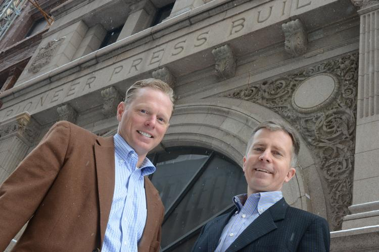 Jerry Bak, CEO of Bridgewater Bank (left) and Rich Pakonen, co-owner of Pak Properties stand in the Pioneer Press Building in St. Paul, MN.