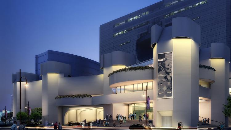A rendering of the renovated Alley Theatre at dusk.  Click through the slideshow to see more renderings of the Alley Theatre facility and photos of UH's Wortham Theatre.