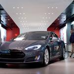 Texas Gov. <strong>Rick</strong> <strong>Perry</strong> swerves into debate on Tesla vehicle sales