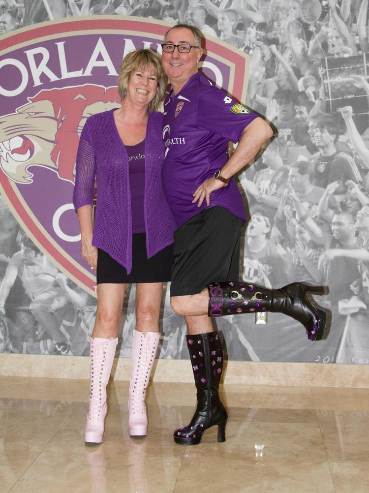 Orlando City Soccer President and Owner Phil Rawlins and his wife, Kay, show support for the Walk a Mile in Her Shoes campaign.
