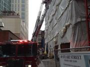 Boston Fire Department crews at 45 Stuart St. this morning.