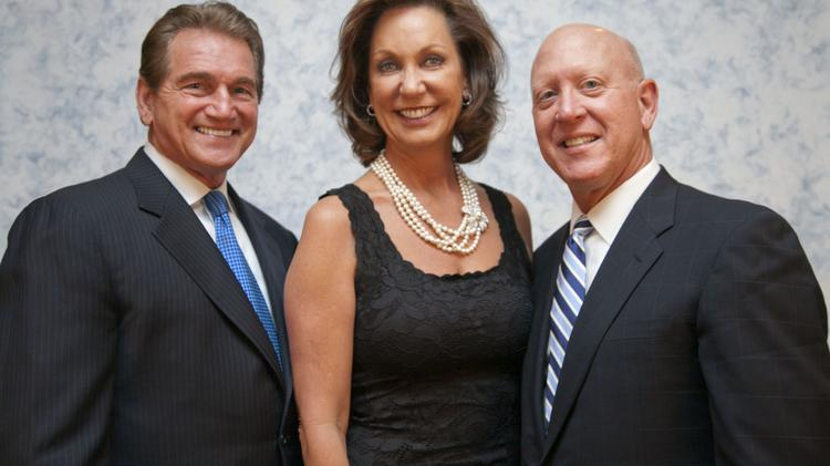 Joe Theismann (left), former quarterback for the Washington Redskins, spoke at the Arrupe Jesuit High School fundraiser. With him are Margaret Kelly and her husband Joe Kelley, who's chair of the school's board of trustees.