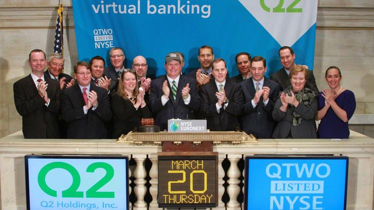 Q2 Holdlings Inc. Chairman Hank Seale, in the hat, with CEO Matt Flake to his immediate left at the opening bell of the company's initial public offering on Thursday.