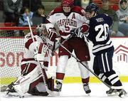 Jesse Root, a starting center for the Yale Bulldogs, is positioning himself to score in front of Harvard's net.