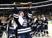 Jesse Root scored the final empty-net goal for Yale in the Frozen Four championship game in Pittsburgh. His father and mother Kathy were there to watch.