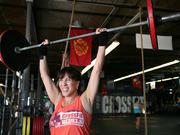 Joy Gendusa, founder and CEO of Postcard Mania, working out at CrossFit in Clearwater.