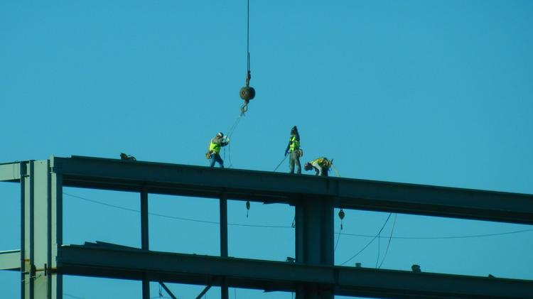 Workers installing the new video boards at Bank of America Stadium, home of the Carolina Panthers.