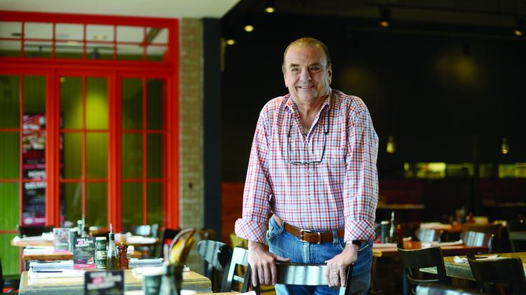 Phil Roberts, CEO of Parasole Restaurant Holdings, said a minimum wage hike would be devastating to the restaurant industry and cost his company hundreds of thousands of dollars