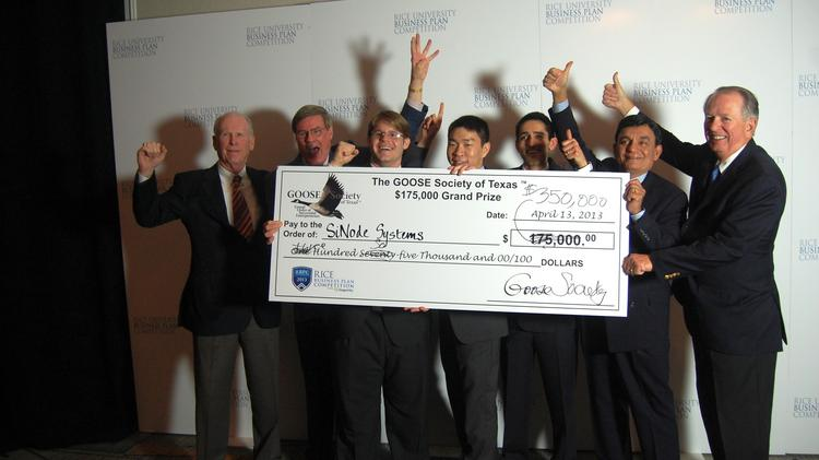 SiNode Systems, the 2013 winner of the Rice Business Plan Competition, poses with the grand prize check of $350,000 from the Goose Society of Texas.